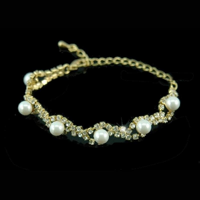 Bracelet fleurs et perles sur monture or
