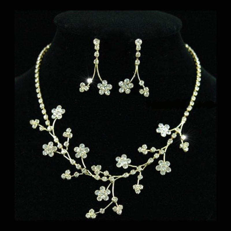 Parure de bijoux or mariage fleurs strass