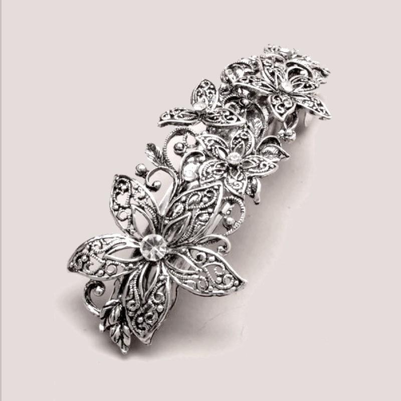 Barrette vintage fleur argentée
