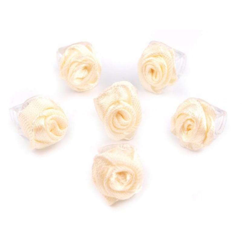 6 petites fleurs ivoire sur pince crabe