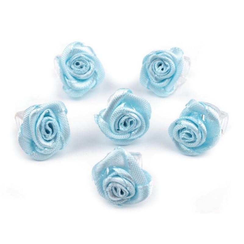 6 petites fleurs bleu sur pince crabe