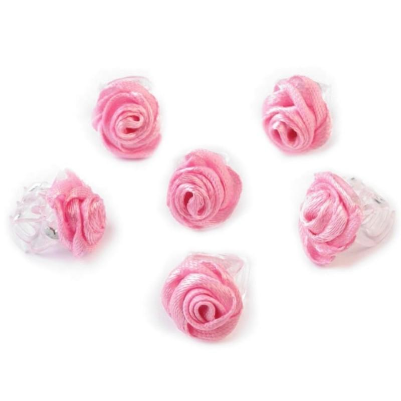 6 petites fleurs rose moyen sur pince crabe