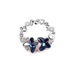 Broche ronde cristal papillon bleu
